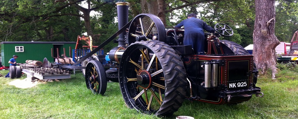 Steam engine running a wood saw on rally day